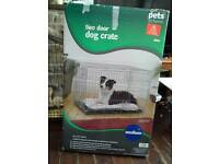 Medium dog crate hardly used in box with guarantee from pets at home rrp £55
