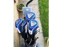 Ben Sawyers golf clubs and a trolley