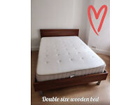 Double size wooden bed