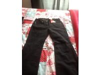 Ladies black jeans, size 12, tags still attached