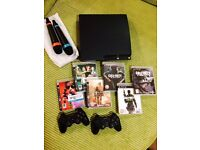 Preowned PlayStation 3 500GB Slim (Grade C) game and accessory bundle