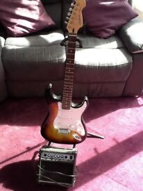 Cruiser by crafter 6 string electric guitar in sunburst and amplifier