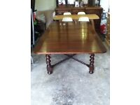 ANTIQUE SOLID OAK DINING TABLE WITH UNIQUE TWISTED BRACE.