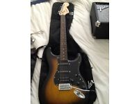Fender strata guitar with case, amp, and tuner