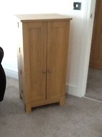 CD Storage unit. Double doors open to store CD's and DVD
