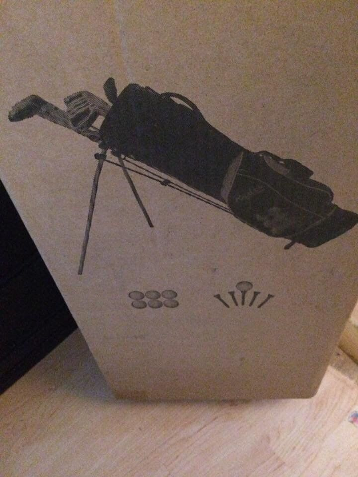 new still in box golf clubs and bag plus tee balls