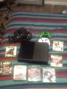 Xbox one and 7 games and 2 controllers