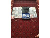 Play station 3 inculding 2 controllers and many games