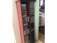 128 CDs and a wooden CD storage unit