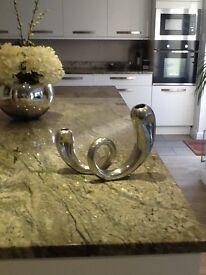 Silver metal contempary twist vase