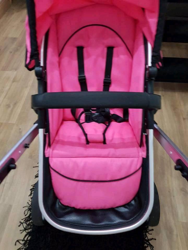 Pink Tectake pram/pushchair