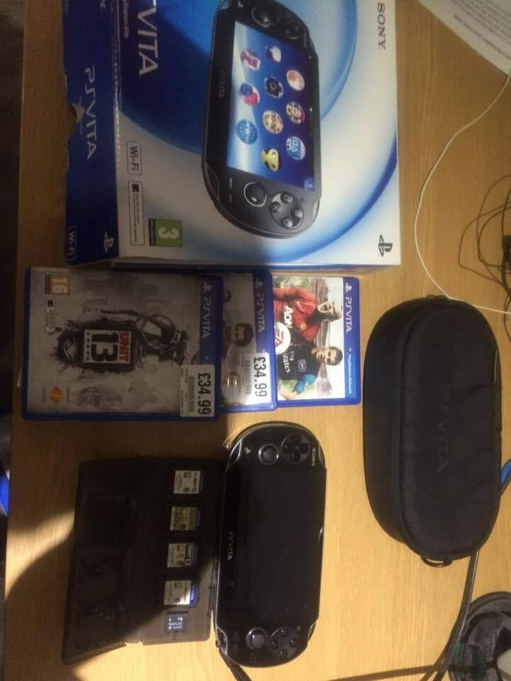 PS Vita Wifi Mint Condition–£130 Comes with 8GB memory card/Cases/ 4 Games/ Glasgow or Edinburgh