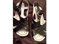 Brand new label on hush puppies sandals