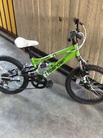 Boys green bike