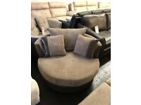 DFS Findlay Cord Fabric Swivel Cuddle Chair