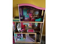girls tall wooden dollshouse mansion with lots of extras/accessories..