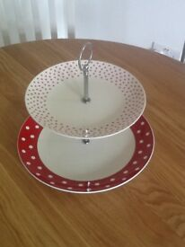 Cake stand, two tiers, white and red. Excellent condition.