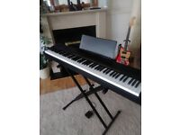 Casio CDP 130 digital piano with stand and music rack