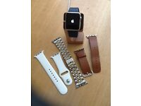 42mm Apple Watch series one with charging stand and 3 straps