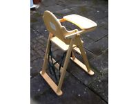 Baby east coast high chair made of wood with blue bumpers