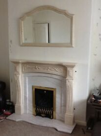 Fire place hearth and mirror .