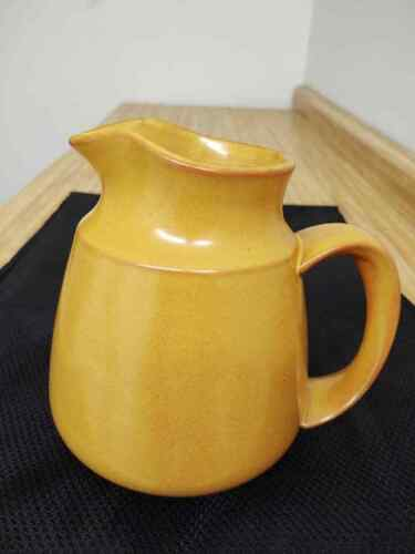 MCM Franciscan gold/mustard milk or water pitcher.