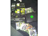 Original Xbox, boxed, all in working order.