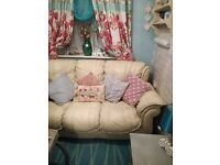 Beautiful cream Italian leather sofa £50..Also shabby chic floral curtains and large turquoise rug