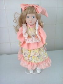 porcelain doll called Jill 16 inch high on stand in a box