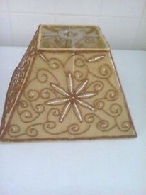gold with brown swirls and brown flower with beads pyramid shape lampshade