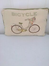 cushion & cover has bicycle motif cream with green trim on one side and bicycles on other side
