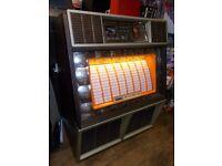 Vintage retro 1970s Rowe Ami Jukebox, in working order, holds 100 vinyl records.