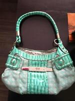 Looking for this purse or one close to it.