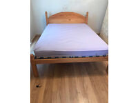 Double solid pine bed frame with good quality mattres.delivery possible