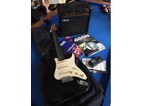 Electric guitar, case, amp, tuner, 2 x books