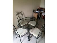ROUND GLASS ORNATE DINING TABLE & CHAIRS