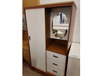 Modern wardrobe with mirror and drawers