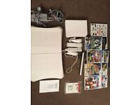 Nintendo Wii + Wii Fit + 8 Games + 1 GB Wii Memory Card