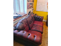 Leather chesterfield sofa red