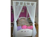 Lovely girls 4 poster single bed, solid white wood, includes all drapes & large storage underdrawer.