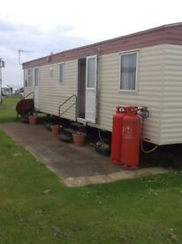 Static caravan to rent in family Friendly Park, walking distance to beautiful sandy beach