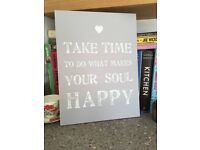 Grey and white wooden wall plaque to 'make your soul happy'