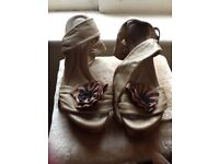 Pair of size 5 high class shoes with wedge heels.