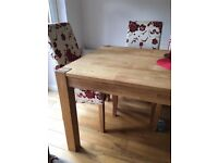 Oak dining room extending table and 6 chairs .