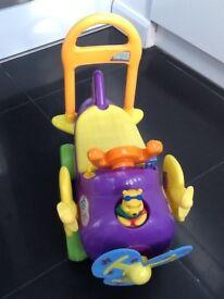 Kid push aeroplane