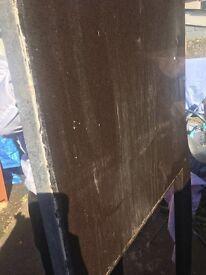 Dark brown slab of granite worktop