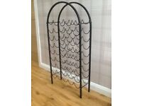 Wine rack in black wrought iron, holds 45 bottles, in excellent condition, must be seen!