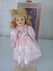 porcelain doll pink/ lace dress on stand height is approx 12 inch