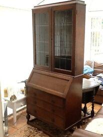 Dark wood writing Bureau with leaded glass display