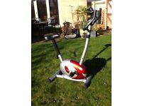 Exercise bike as new with hand pulse sensors and tension controls